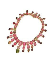 18 KARAT GOLD AND TOURMALINE NECKLACE, TONY DUQUETTE. The flexible bib-style necklace set with numerous tourmaline cabochons in various hues weighing approximately 626.00 carats, gross weight approximately 213 dwts, length 18 inches, signed Tony Duquette.