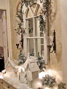 Winter wonderland...idea - paint all remaining houses white and textured snow and white, silver(?) glitter to rooftops, trees...white mini lights to light them up; spray green bottle brush trees with snow.