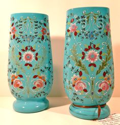 This lovely pair of 19th Century blue opaline glass vases was found in an old estate in Baltimore, MD. They are hand painted and unique. They