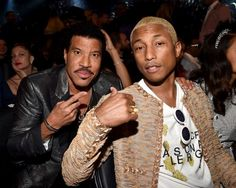Lionel Richie and Pharrell Williams at the 58th Annual GRAMMY Awards on Feb. 15 in Los Angeles