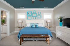 Another blue bedroom ceiling, this one a deeper teal. It looks supercrisp framed by the white ceiling trim. The light warm gray wall and flo...