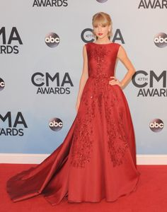 In an Elie Saab gown at the 2013 CMA Awards. See Taylor Swift's full fashion evolution, from sequins in 2007 to her many crop tops today.