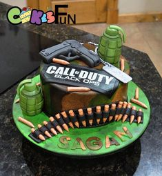 Camoflauge cake with gun and hand grenades. A gamers cake. All decorations made with marshmallow fondant. : Camoflauge cake with gun and hand grenades. A gamers cake. All decorations made with marshmallow fondant. Army Birthday Cakes, Army's Birthday, Fondant Cakes, Cupcake Cakes, Playstation Cake, Nerf Gun Cake, Call Of Duty Cakes, Gun Cakes, Tank Cake
