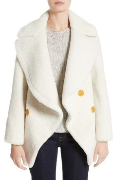 Women's Burberry Teddy Genuine Shearling Pea Coat by Burberry  Women's Burberry Teddy Genuine Shearling Pea Coat by Burberry  Available Colors: White  Available Sizes: 2  DetailsStraight from the see-now-buy-now spring 2017 collection this cocoon-like pea coat is cut from beautifully plush lamb shearling and detailed at the back by chunky knit cables for a rich play on texture. A bit of lambskin leather peeks out from behind if you pop the collar calling further attention to the sculptural…