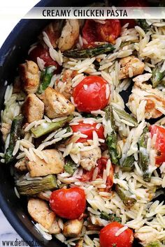 Creamy Chicken Pasta, loaded with chicken, orzo, asparagus, and tomatoes, tossed in a creamy sauce.