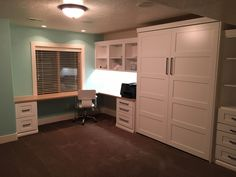Our customer chose the BedderWay Vertical Queen Lake View Face Murphy bed in maple painted white with brushed black modern pulls along with a workstation.