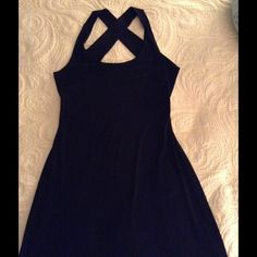 Little Black Dress with flair by Calvin Klein Calvin Klein black dress with a cross cross back. I wore it one time to a Christmas party last year. It has a thin tulle slip in the skirt with a slight high/low edge. Wear it with a jean jacket or a little fur. Calvin Klein Dresses