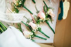 pink rose bud and gyp button holes  | Photography by http://www.emilytylerphotography.com/