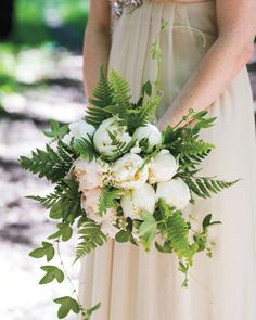 Passion vines and ferns framed this peony and lily of the valley bouquet by Brown Paper Design.