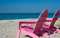 Hot pink beach chairs on Sanibel Island by Rachelle Vance