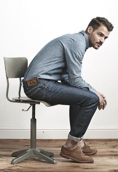 Shop this look for $133:  http://lookastic.com/men/looks/blue-chambray-longsleeve-shirt-and-charcoal-jeans-and-brown-suede-derby-shoes/422  — Blue Chambray Longsleeve Shirt  — Charcoal Jeans  — Brown Suede Derby Shoes