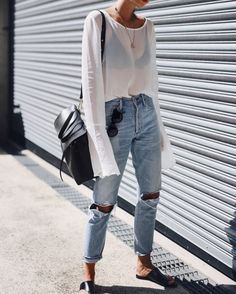 sheer white tee styled with light jeans  similar style available on siizu.com
