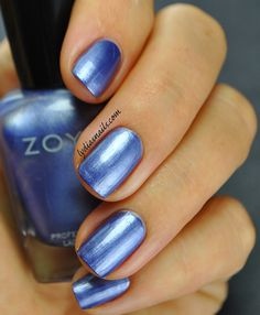 Zoya Prim Prim: Velvet blue metallic, with a full coverage, high-density pigment and buttery smooth application. They are not kidding when they say buttery smooth application! This one was a one coater, I did two but you can only do one! Great formula! Swatch is without top coat.