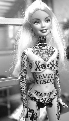 Badass Barbie...love her throat tattoo. Some day
