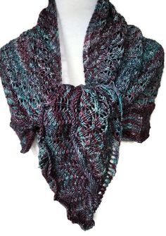 Such a comfy blend of Turquoise and Purple in this Merino Wool Lacy Hand Knit shawl. Beautifully shaped in a triangle with a solid center stitch and wonderful lace border of waves.  The lace pattern of this wrap is repeated throughout the body and creates a very airy look. Handknit wrap measures 58 tip to tip and 30 down center stitch to the very point. Edging has a soft chevron quality. The lace throughout makes this wrap very feminine and elegant but would blend beautifully #cpromo ...