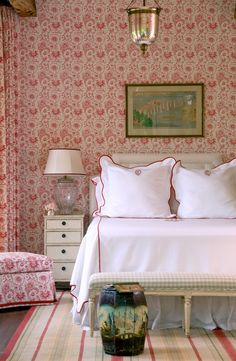 Red and white floral bedroom with white coverlet on bed | Cathy Kincaid Interiors