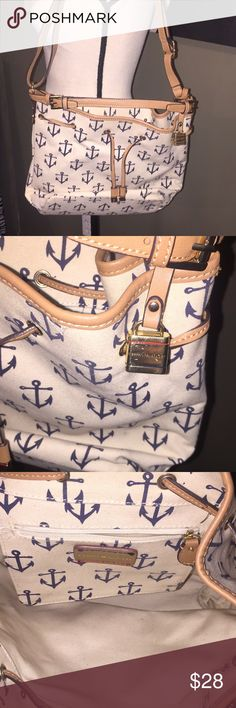 Adorable Tommy Hilfiger Anchor Nautical Purse Gently used, Tommy Hilfiger purse with anchors. There is plenty of space on the inside with a smaller compartment (zipper pouch) on the inside. Super cute! We accept reasonable offers and ship quickly! Thank you for looking! Tommy Hilfiger Bags Shoulder Bags
