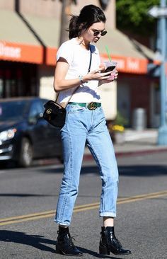 On Kendall Jenner: Ray-Ban 50mm Rounded Sunglasses($150); Re/Done|Hanes The 1960s Slim Tee($78); Gucci GG Marmont 2.0 Bag($1890) and Gucci Ayers Belt with Double G...