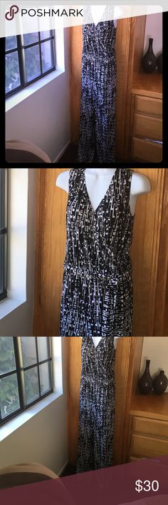 Chico's Black and Whit Jumpsuit This knit jumpsuit features a deep v top with wide-band straps and elastic waistband. Wide leg  silhouette. Chico's size 1 (women's size 8). Fabric: 95% Polyester, 5% Spandex Chico's Pants Jumpsuits & Rompers
