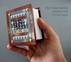 V Steamworks World's first LEGO Book. All LEGO, with a fully functional spine, cover and pages.    The 'pages' are printed on vinyl. 2009