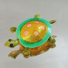 This #vintage turtle brooch is gorgeous and fun!  It features a gold tone turtle with painted with colorful enamel in greens, gold and pinks.  Rolling C-clasp.  A perfect ad... #ecochic #etsy #jewelry #jewellery #rhinestones #holiday2014etfs