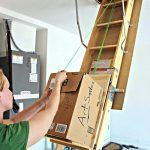Store items in your attic with ease with this DIY attic storage lift!