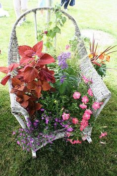Old wicker chair repurposed - so beautiful and I see old wicker furniture... Old wicker furniture makes gorgeous designing arrangement pieces.. My Complete Weakness... This will be a part of my patio definitely... Along with all of my other wicker sets of furniture... :)
