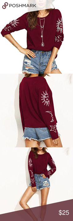 Sun, Moon, Star Printed Top The knit tee top featuring a sun,moon and star graphic print, long Sleeve, and crew neckline.   color: burgundy Tops Tees - Long Sleeve