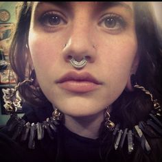 Septum, double nostril and stretched lobes.