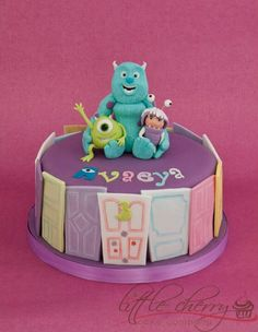 I LOVE this, but no way I can justify for the little party this year.  Mike, Sully & Boo cake by Little Cherry cake company <3