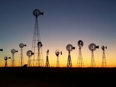 Windmills - As I left Forestburg one evening and passed through Montague going south, the sun was setting behind a ranch museum, and I quickly snapped two shots with my wife's digital camera before the light changed. A Texas-ranch-country shot.