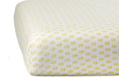 Organic fitted crib sheets in Booti Yellow are a must-have for your nursery!  rikshawdesign.com