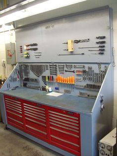 I like this idea of putting toolbox cabinets under a workbench.