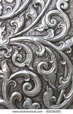 Ancient Silver Embossed Book Cover | metallic texture embossed into an ancient doorway - stock photo