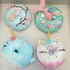 Mermaid and unicorn donut by @spudnutsdonuts . OMG i am fan !!!  #unicorns #unicorn #mermaid #flowers #flower #fish #sirene #donut #donuts #blue #pastel #pink #glitter #macarons #donuts #cupcakes #pearl #smell #cake #cakes #food #foodart #foodporn #art #photooftheday #picoftheday #amourducake