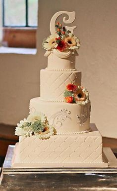 4 tier ivory wedding cake with square and round alternating tiers and monogram topper.JPG 2