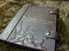 The Necronomicon iPad / tablet / eReader cover! Written by the crazed Abdul Alhazred, this ancient, mouldy tome contains untold arcane knowledge, incantations to summon elder gods, and access to boundless networks.