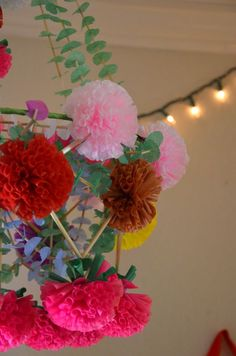 """Polish folk art paper chandeliers known as PAJAKI"" in the studio of uber-talented Mary Ann Moss. Check her OUT!"
