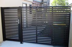Clik'n'Fit Colorbond steel side fence including gate.