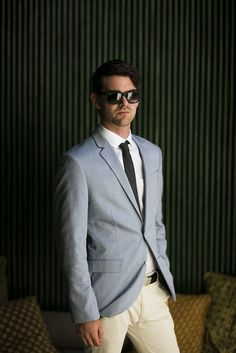 #Bali inspired #groom #attire : crisp white #shirt , light #blue #blazer , off-white #trousers , dark colored #tie , #belt and #rayban #sunglasses . See the #wedding at http://www.wellgroomedblog.com/2016/06/well-groomed-groom-bali-inspired-modern.html