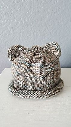 These little preemie sized bear cub hats came about when my daughter requested something for her twin sons to wear during their stay in the NICU. The pattern can easily be made larger, for newborn or older babies, by sizing up on yarn and needles.