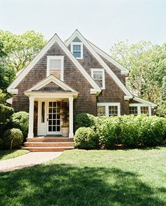 Exterior Photo - A brick pathway leading to a house with shingle siding - I'm such a huge brick person, and this would be a way to incorporate bricks into my house without dealing with the negative aspects of a brick house