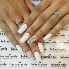 Laced Up White Nail Art Design. Coffin nails are the best to try nail art with. And this laced up white nail art design is perfectly made for your beautiful and elegant coffin nails.