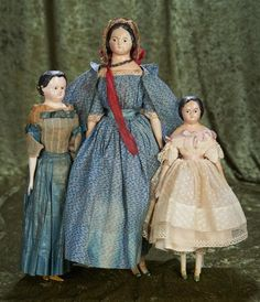 Three German paper mache dolls with sculpted hair and original costumes 800/1100 Auctions Online | Proxibid