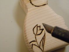 woodworking - the finishing touches to basic wood toys, sanding, wood burning, painting and beeswax polish