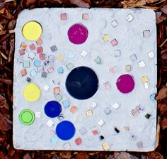 More stepping stone art for the Butterfly Garden. Created by students in our school from reused/recycled materials.