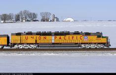 Looking more like a model locomotive, the last operating Union Pacific Centennial DD40X, UP 6936 East, is seen in a pan shot from an ice covered farm road just east of Round Grove, Illinois on Feb. 15, 2008.