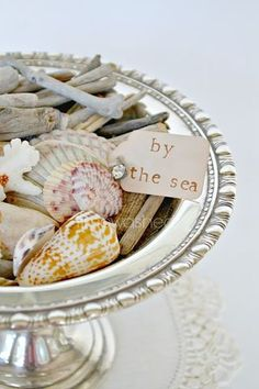 Add a tag to a beachcomber display. Love the shells displayed in the silver bowl. Seaside Decor, Beach House Decor, Coastal Decor, Cottages By The Sea, Beach Cottages, Coastal Homes, Coastal Living, Playa Beach, Vintage Bowls