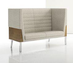 Towering backs make for an enveloping sit. Photo Credit: INTERIOR DESIGN Magazine