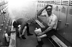 Another two miners get changed out of their work clothes in one of the locker rooms at Horden Colliery. The image is part of a new collection shedding light on the day in the life of a coal miner